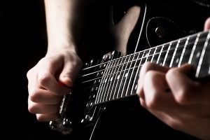 band_electric_guitar_being_played_up_close-18