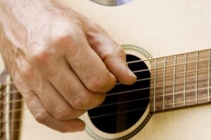 acustic_guitar_being_played_up_close_ExploreOCMD-5